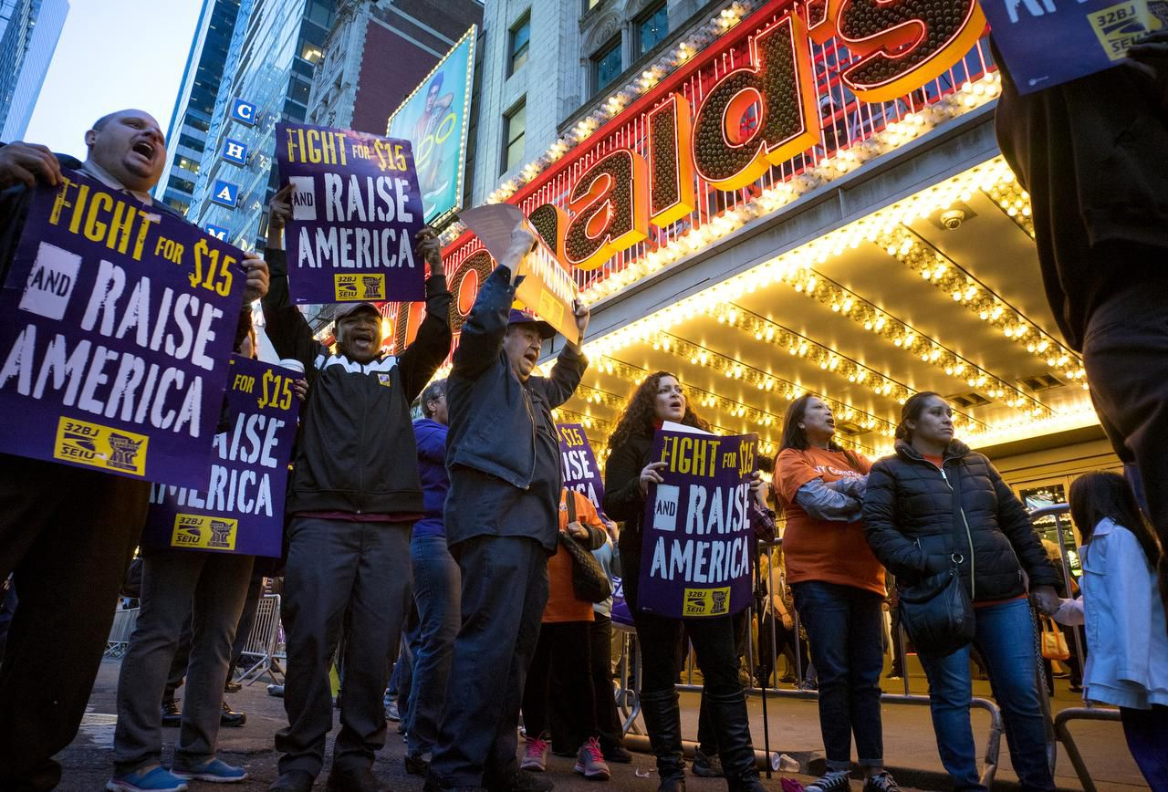 Protestors pause near a McDonald's restaurant in Times Square during a rally and march in New York, as participants, fast food workers and union members call for a $15 minimum wage.