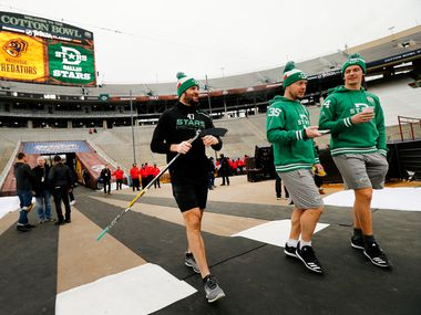 Dallas Stars right wing Alexander Radulov (47), goaltender Anton Khudobin (35) and left wing Roope Hintz (24) get acclimated to the cold weather before their outdoor NHL Winter Classic hockey game with the Nashville Predators at the Cotton Bowl in Dallas, Wednesday, January 1, 2019.