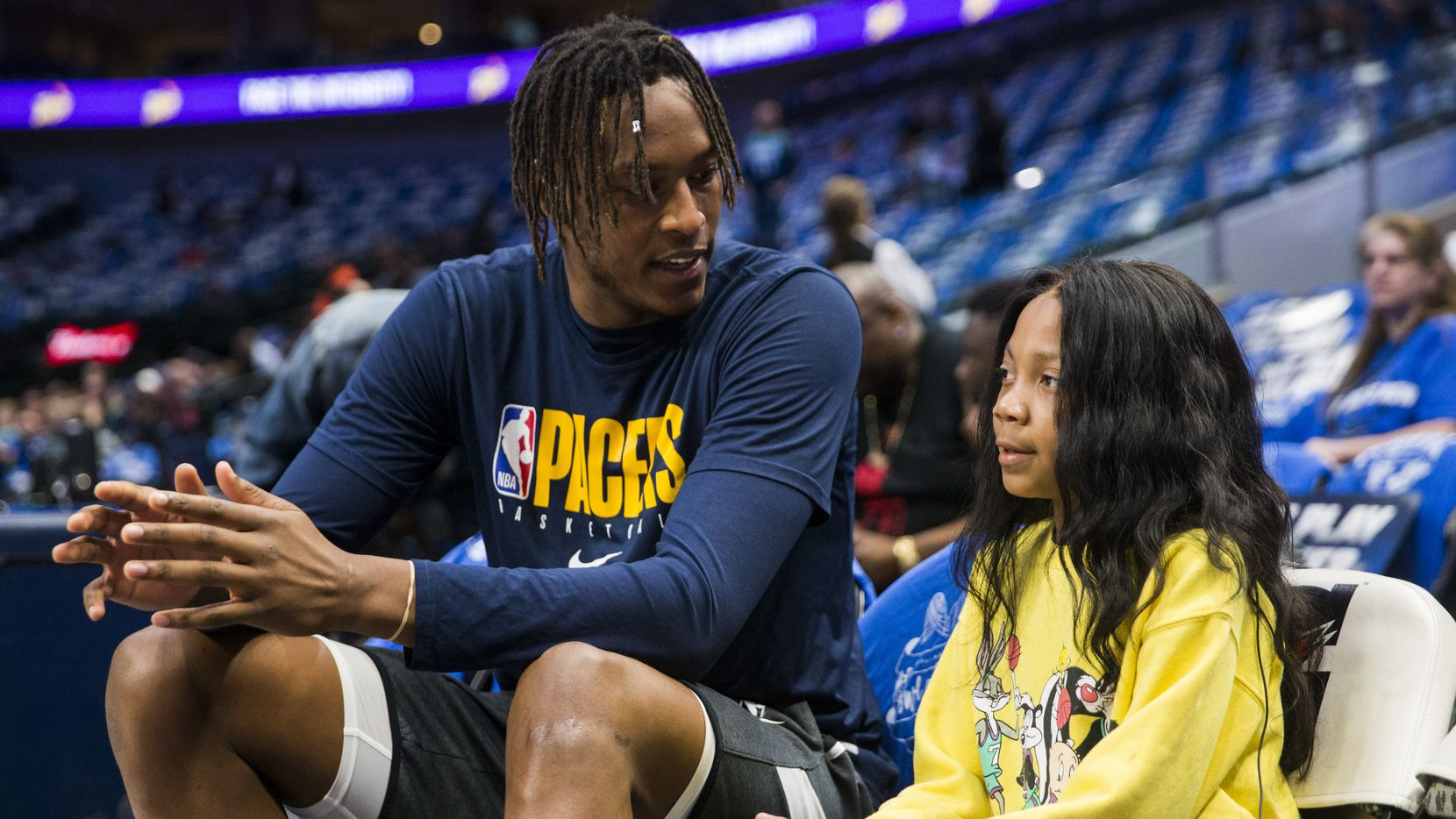 A'Myah Moon (right), 11, talks with Indiana Pacers center Myles Turner (33) before an NBA game between the Indiana Pacers and the Dallas Mavericks on Sunday, March 8, 2020 at American Airlines Center in Dallas. Moon, who has a rare cancer, was bullied at school. Turner and his family reached out to help and met with Moon before the game.