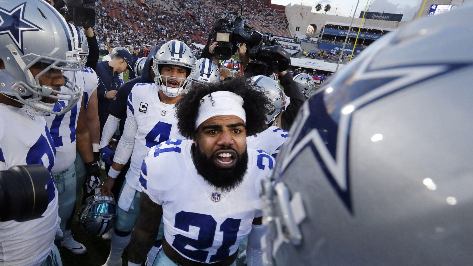 Dallas Cowboys players get fired up by running back Ezekiel Elliott (21) before their NFC Divisional Playoff game against the Los Angeles Rams at Los Angeles Memorial Coliseum in Los Angeles, Saturday, January 12, 2019. (Tom Fox/The Dallas Morning News)