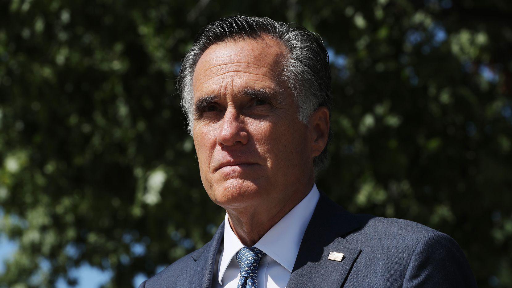 Sen. Mitt Romney, R-Utah, leaves a meeting of GOP senators at the National Republican Senatorial Committee offices Sept. 22, 2020 in Washington.