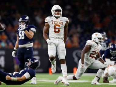HOUSTON, TX - SEPTEMBER 14:  Juwan Mitchell #6 of the Texas Longhorns celebrates after sacking Tom Stewart #14 of the Rice Owls in the second half at NRG Stadium on September 14, 2019 in Houston, Texas.