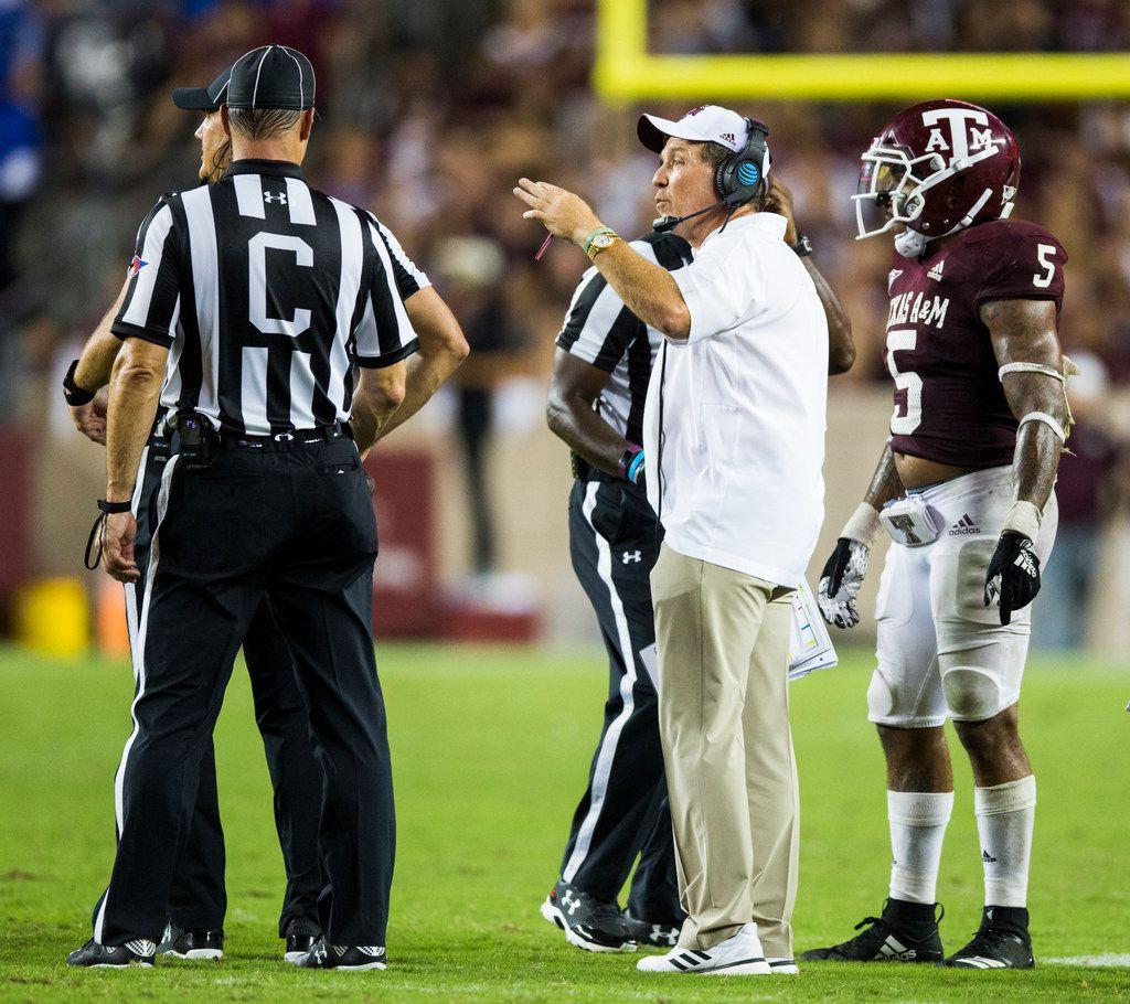 Texas A&M Aggies head coach Jimbo Fisher talks to officials about the rules of overtime after the fourth quarter of an NCAA football game between Kentucky and Texas A&M on Saturday, October 6, 2018 in College Station, Texas. (Ashley Landis/The Dallas Morning News)