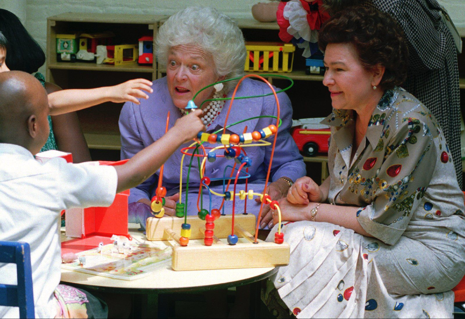 First lady Barbara Bush and Russian first lady Naina Yeltsin played with children during a visit to the children's program at Martha's Table in June 1992. Martha's Table is a non-profit organization that serves homeless and hungry people in Washington,D.C.