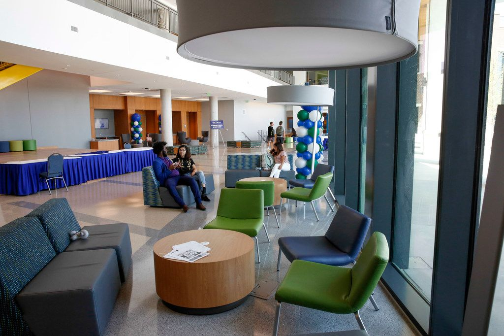 Students sit in the lobby of the new Student Center building opened on the campus of UNT Dallas Monday, August 26,  2019. (Brian Elledge/Staff Photographer)