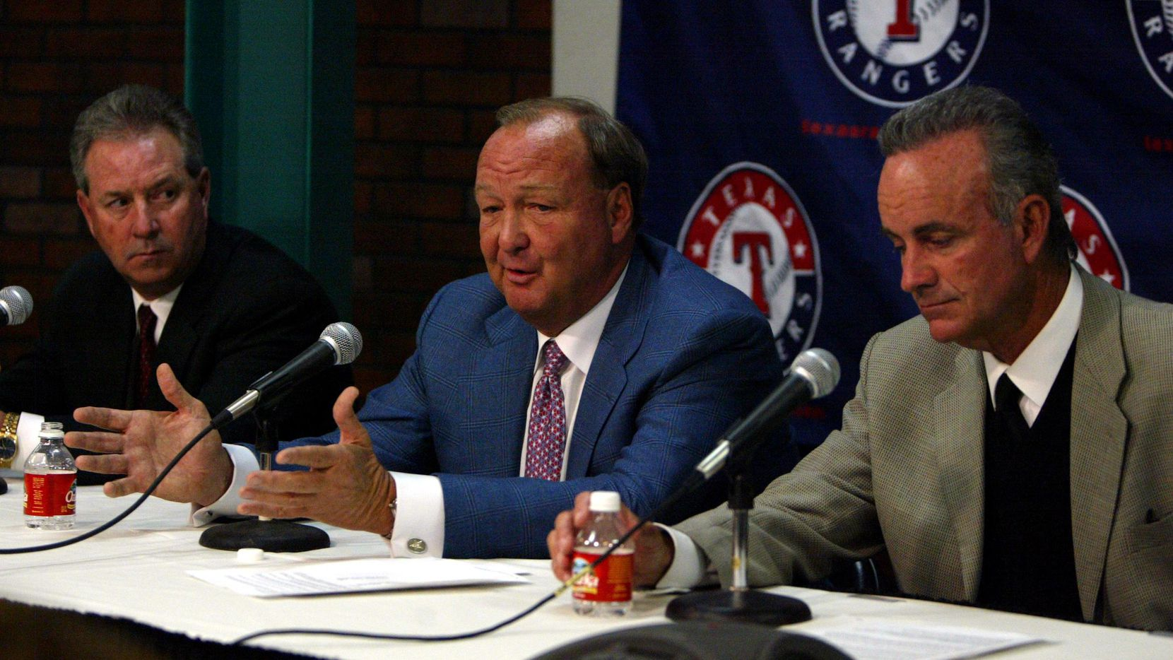 ORG XMIT: *S1851C4DA* Shot Monday,  February 16, 2004 --- DIGITAL # 64396 --- Texas Rangers Assistant General Manager Grady Fuson (left to right); Owner Tom Hicks and General Manager John Hart and speak at a press conference at the Ballpark in Arlington. They announced the trade of former Texas Rangers shortstop Alex Rodriguez to the New York Yankees for second baseman Alfonso Soriano and a player to be named later.
