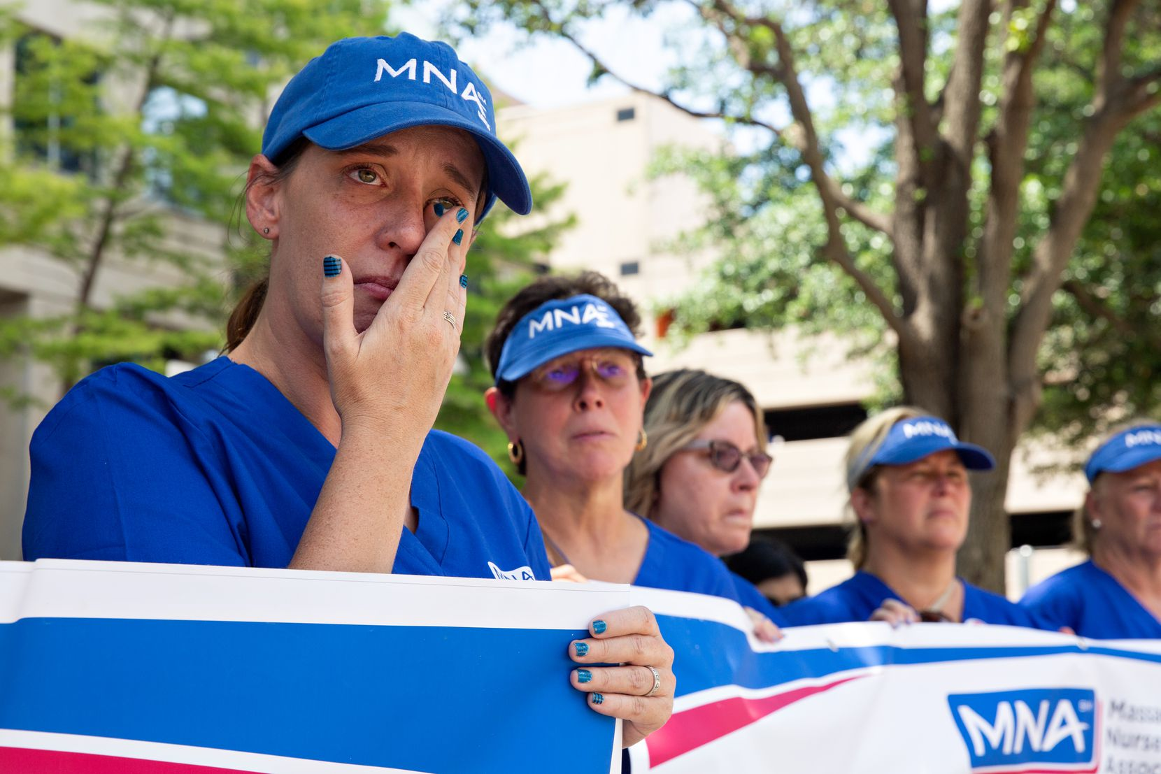 """Nurse Carla LeBlanc sheds a tear outside Tenet Healthcare headquarters. """"It really is like post-traumatic stress. The anxiety of this, I don't know if I'll ever get over it,"""" she said."""