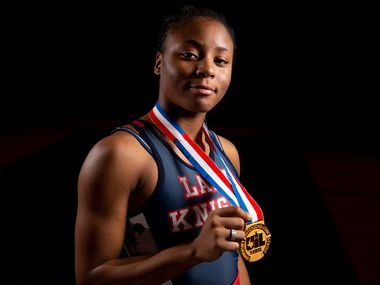 Wrestler Destiny Miles poses for a photograph at Kimball High School in Dallas on Thursday, Feb. 28, 2019. Miles became the third female wrestler state champion from Dallas Independent School District.  (Shaban Athuman/The Dallas Morning News)