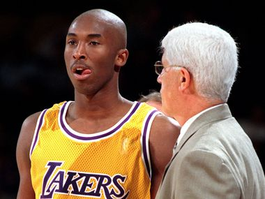 Laker rookie, 18-year-old Kobe Bryant listens to coach Del Harris during a break in the action during game in his first season, in January 1997, at the Forum.