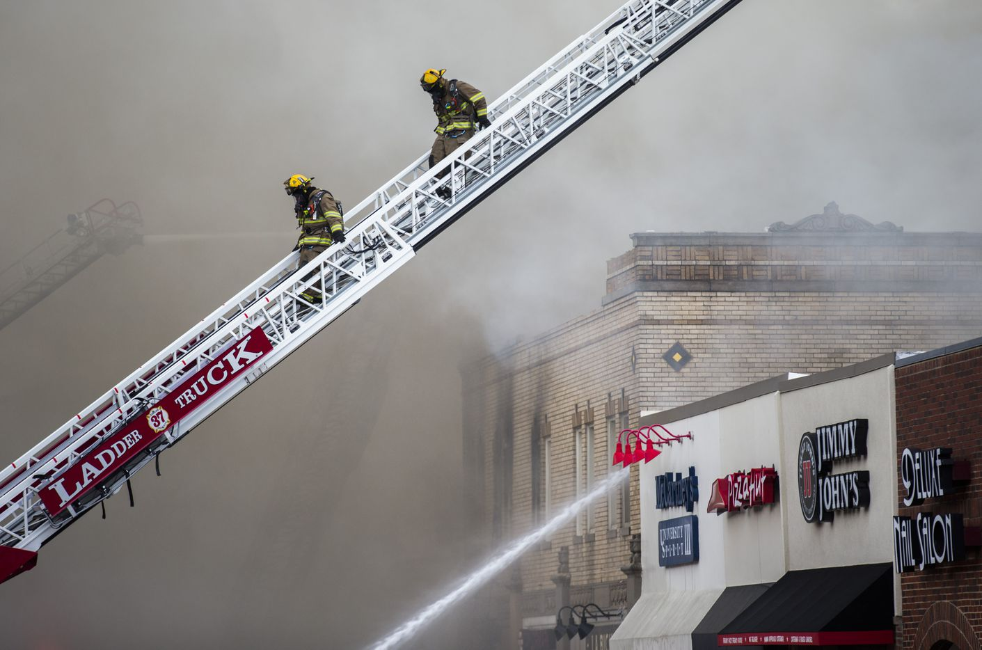 Firefighters battle flames at Goff's Hamburgers on Friday, August 12, 2016 on Hillcrest Avenue near the SMU campus in University Park. (Ashley Landis/The Dallas Morning News)
