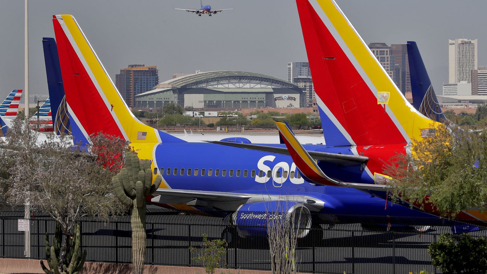 A Southwest Airlines jet makes its final approach at Sky Harbor International Airport in Phoenix.