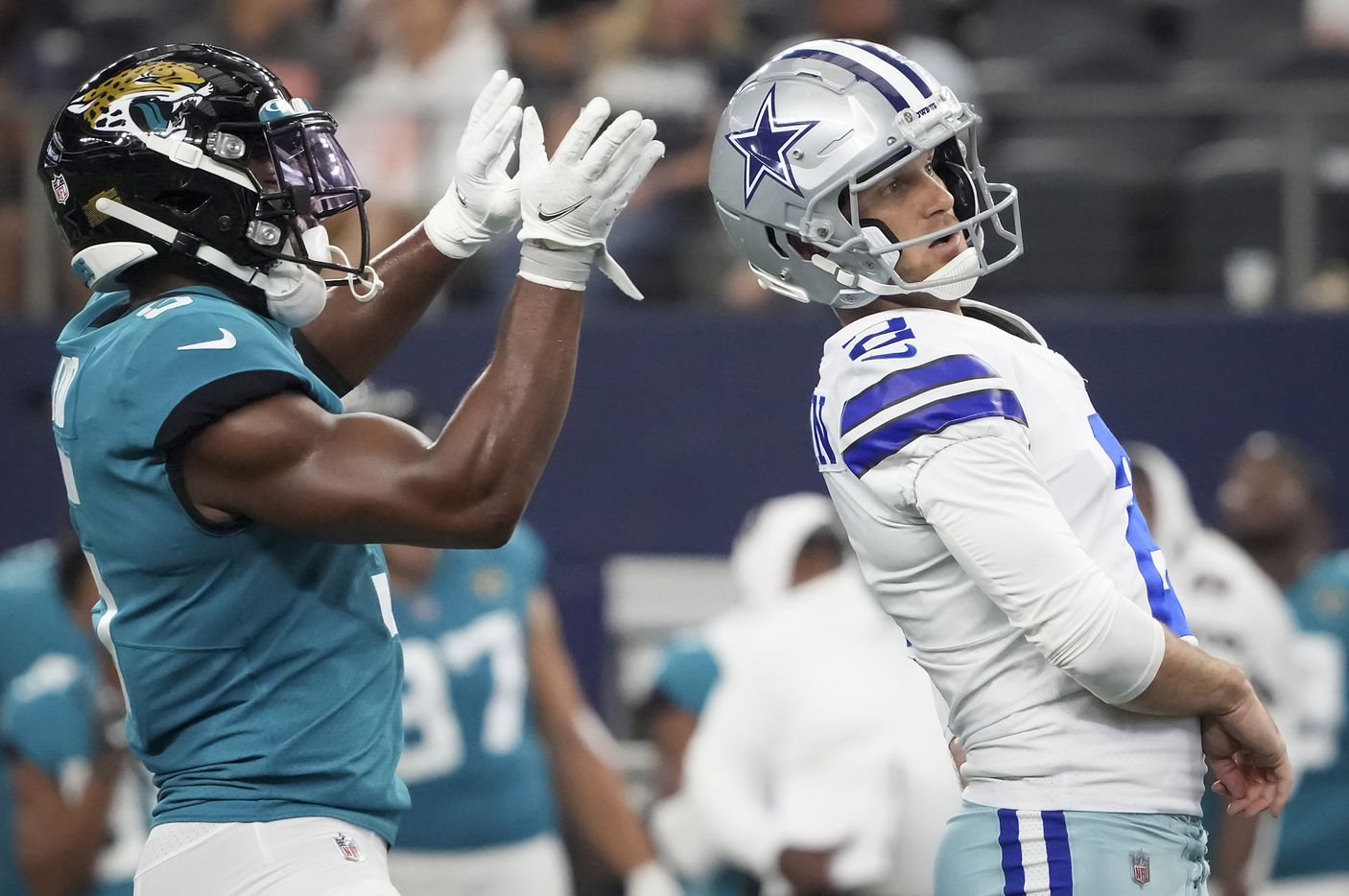 Dallas Cowboys kicker Greg Zuerlein reacts after missing on a 56-yard field goal as Jacksonville Jaguars defensive back Rudy Ford (5) celebrates during the first half of a preseason NFL football game at AT&T Stadium on Sunday, Aug. 29, 2021, in Arlington. (Smiley N. Pool/The Dallas Morning News)