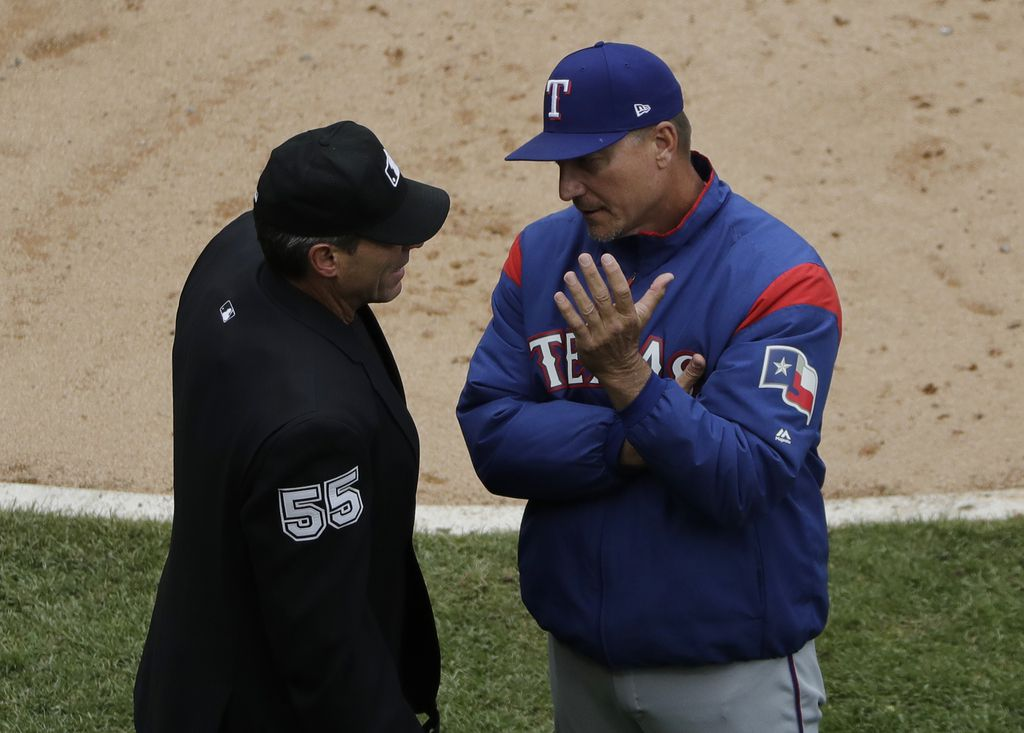 Texas Rangers manager Jeff Banister, right, talks with home plate umpire Angel Hernandez during the fourth inning of a baseball game against the Chicago White Sox, Sunday, May 20, 2018, in Chicago. (AP Photo/Nam Y. Huh)