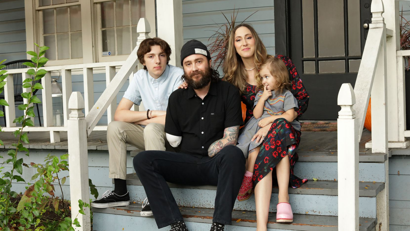 Jude Cooper, left, Jeff Saenz, Monica Cooper and Lola Saenz pose outside their Dallas home on Oct. 1.