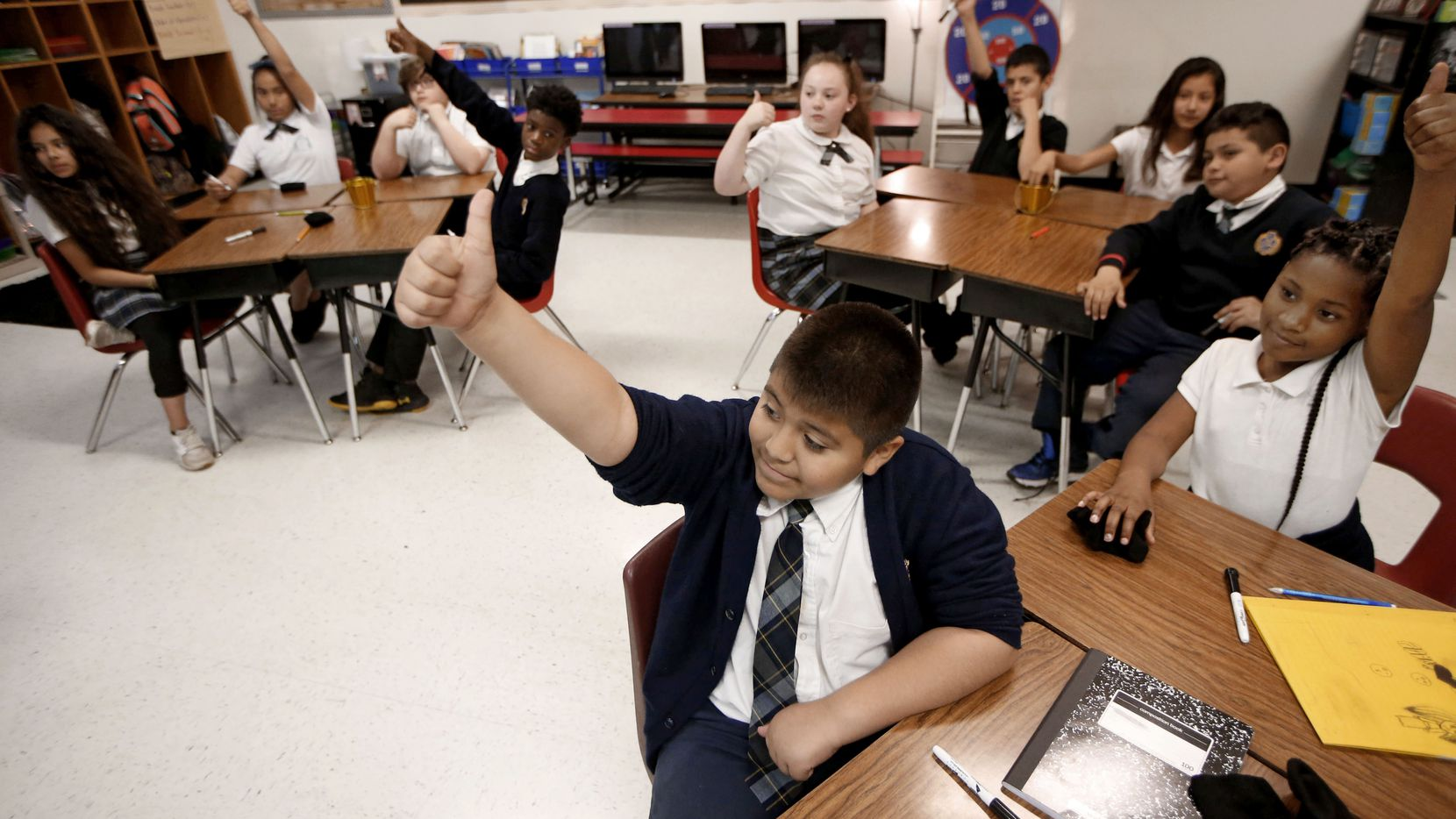 Adrian Torres gives the thumbs up to a correct answer during his fifth grade math class at Annie Webb Blanton Elementary in Dallas on May 17, 2018. Blanton Elementary is one of Dallas ISD's ACE schools where extra money and resources have been poured in to bolster struggling campuses.