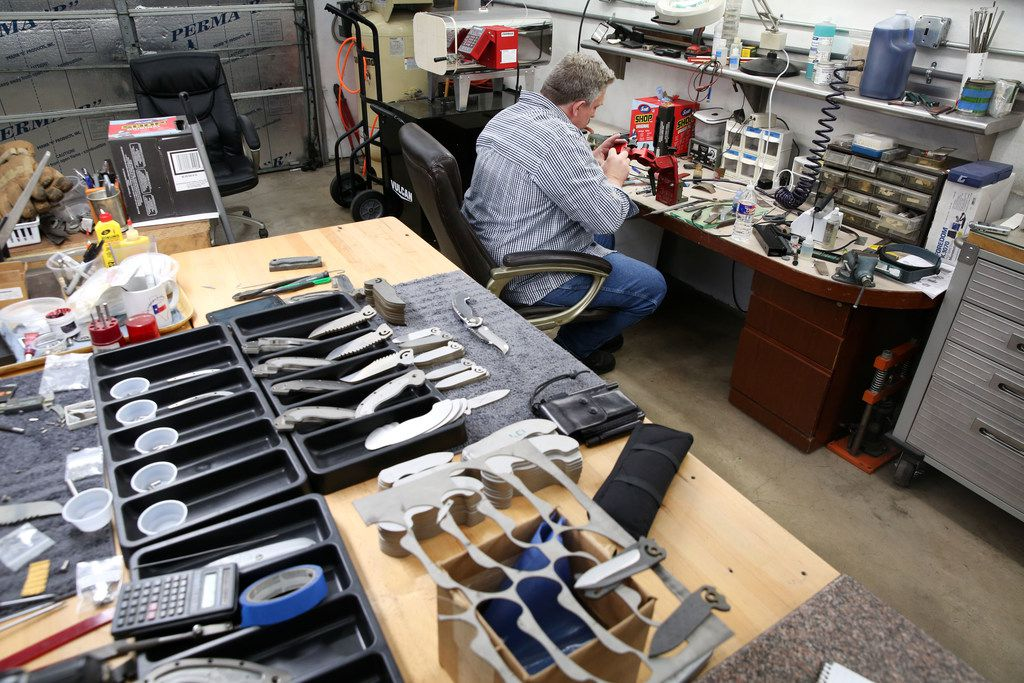 Todd Begg crafts a knife at his shop in Dallas on Jan. 17.