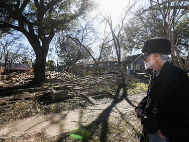 Michael Koler stops to see the remnants of the house 5532 Richard Ave. in Dallas' Vickery Place neighborhood.