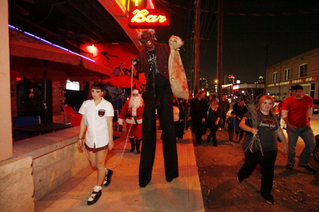 A Krampus character walks passed bars along Elm Street during the Dallas Krampus Walk through the streets of Deep Ellum, organized by the Krampus Society and Dark Hour Haunted House, on Friday, Dec. 5, 2014.