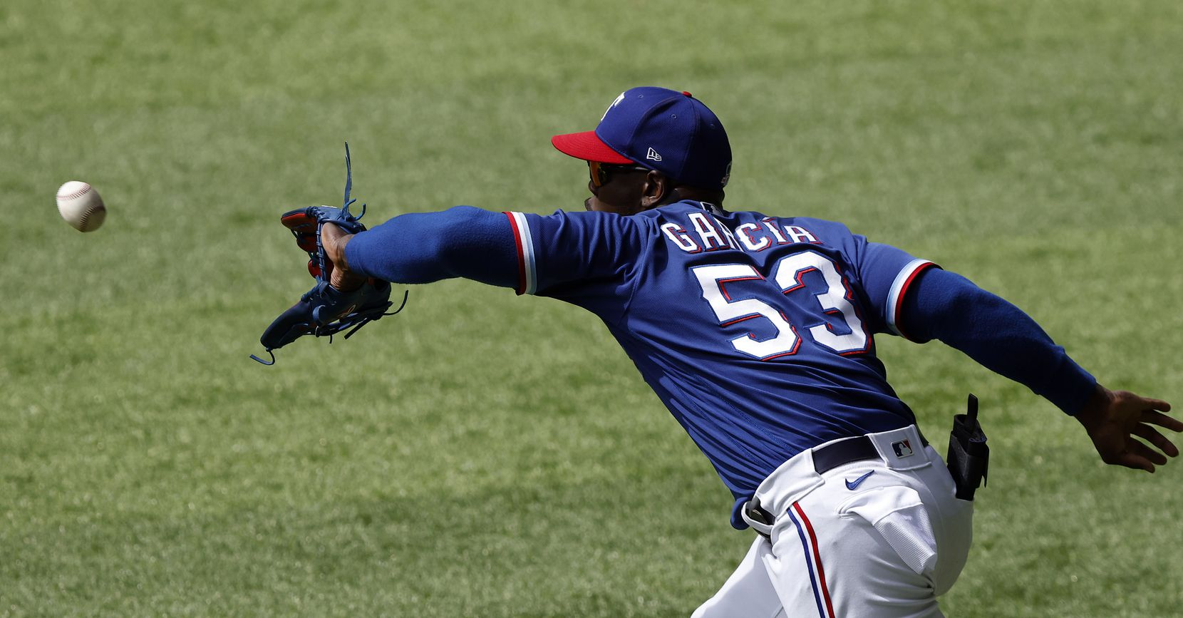 Texas Rangers right fielder Adolis García snares a line drive by Milwaukee Brewers batter Corey Ray in the eighth inning at Globe Life Field in Arlington, Texas. The teams were playing in an exhibition game, Tuesday, March 30, 2021. (Tom Fox/The Dallas Morning News)