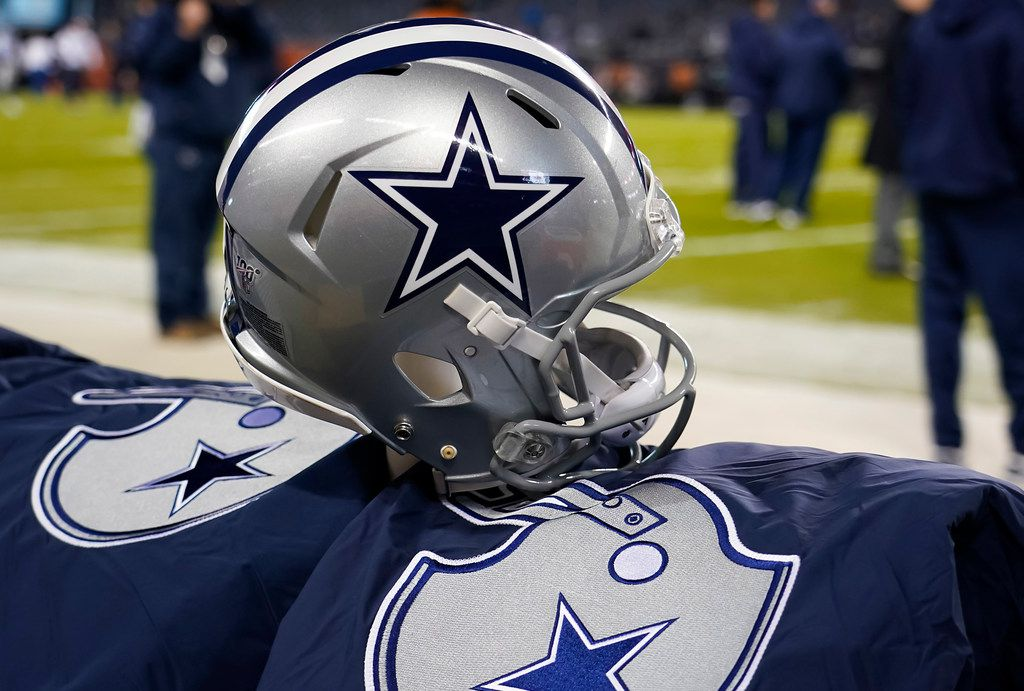 FILE - A Cowboys helmet is pictured on the bench before a game against the Bears at Soldier Field on Thursday, Dec. 5, 2019, in Chicago.