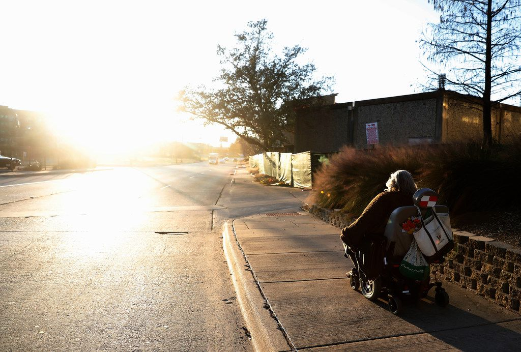 Melody Townsel maneuvers her wheelchair as she heads to her home in The Cedars neighborhood in Dallas.
