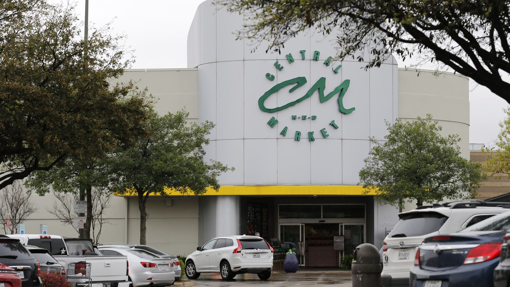 The Central Market parking lot off of Lovers Lane in Dallas on Saturday. Shopping for staples has increased at grocery stores due to the coronavirus.