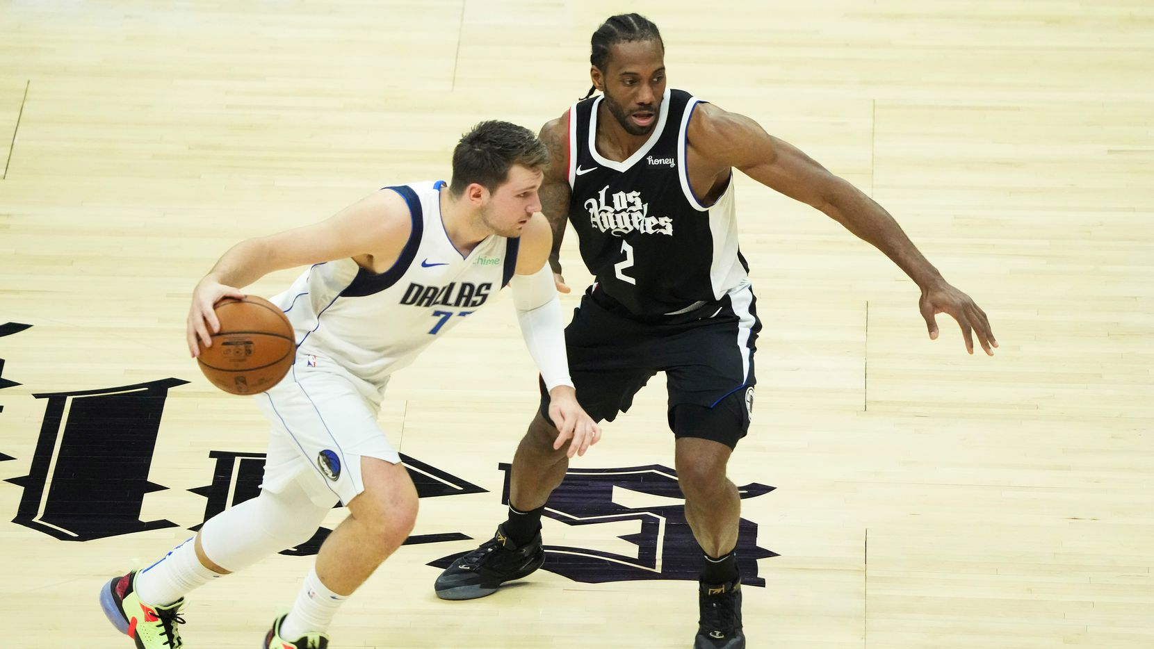 Dallas Mavericks guard Luka Doncic (77) works against LA Clippers forward Kawhi Leonard (2) during the first quarter of Game 7 of an NBA playoff series at the Staples Center on Sunday, June 6, 2021, in Los Angeles.