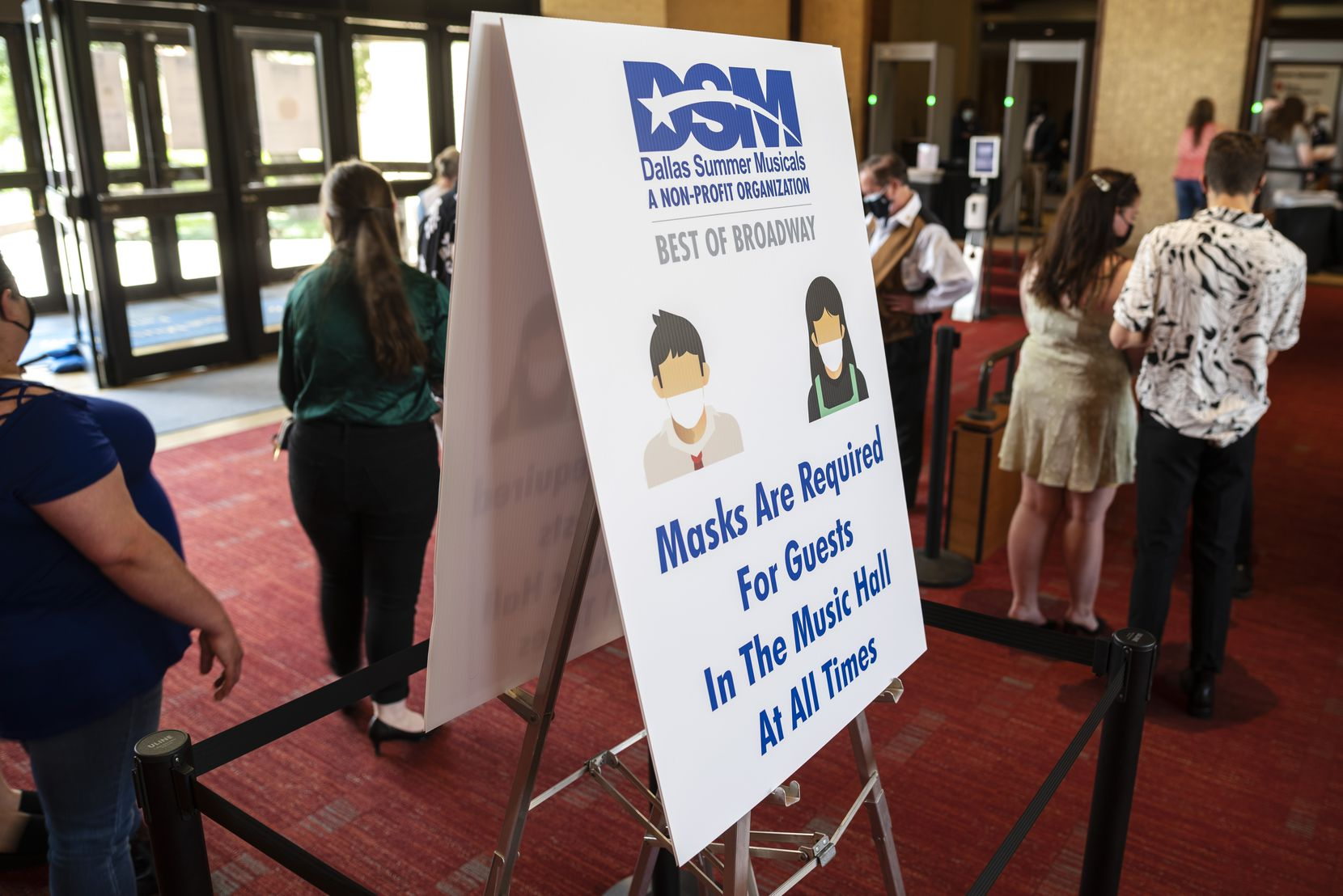 """Signage at the Music Hall at Fair Park informs patrons of the mask requirements to attend """"Wicked,"""" presented by Dallas Summer Musicals."""
