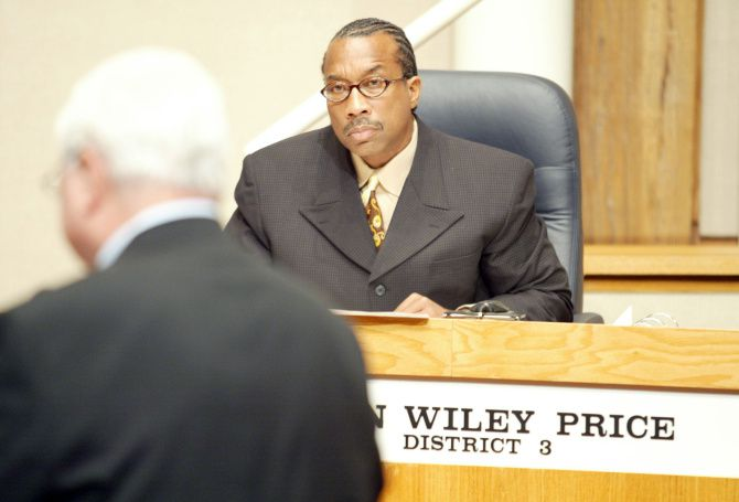 John Wiley Price got large sums from his political consultant, Kathy Nealy, while she received payments from an IT firm he was instrumental in hiring, FBI agents say.