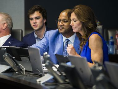 From left, CEO and Executive Vice President Stephen Jones, his son John Stephen Jones, Vice President of Player Personnel Will McClay, Dallas Cowboys executive vice president and Chief Brand Officer Charlotte Jones-Anderson wait to make their first round pick in the war room on Thursday, April 26, 2018 at The Star in Frisco, Texas.