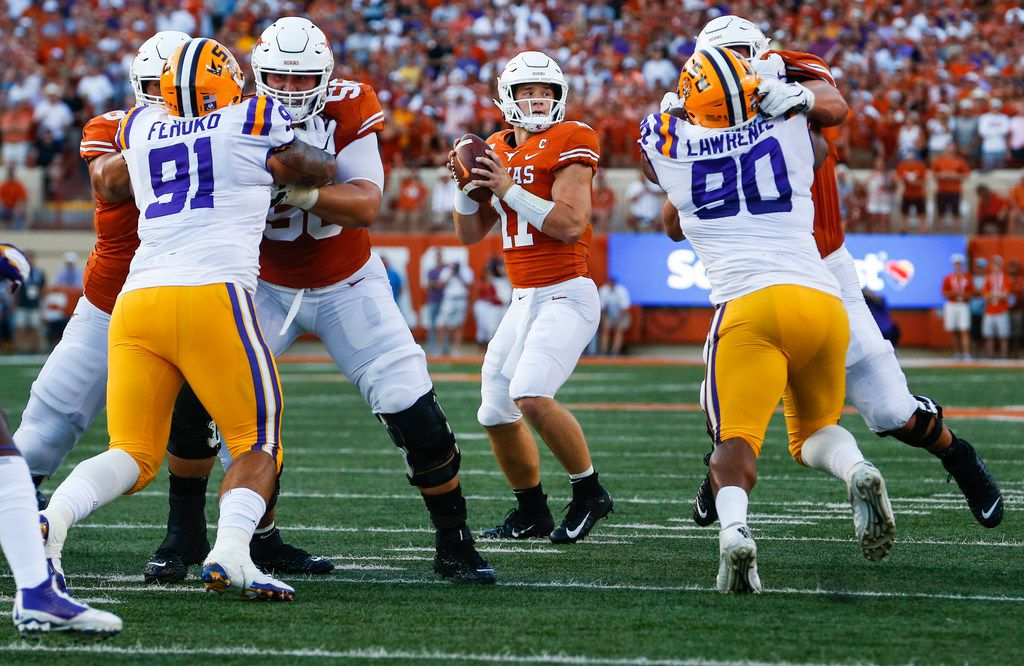 Texas Longhorns quarterback Sam Ehlinger (11) looks for a receiver during the first quarter of a college football game between the University of Texas and Louisiana State University on Saturday, Sept. 7, 2019 at Darrell Royal Memorial Stadium in Austin, Texas.