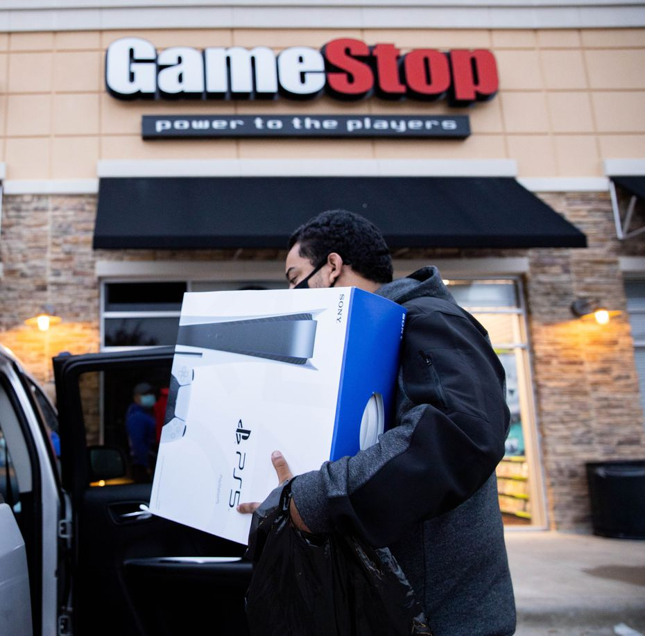 Brandon Lopez of Irving loaded a Playstation into his car that he scored on Black Friday at a Dallas GameStop.