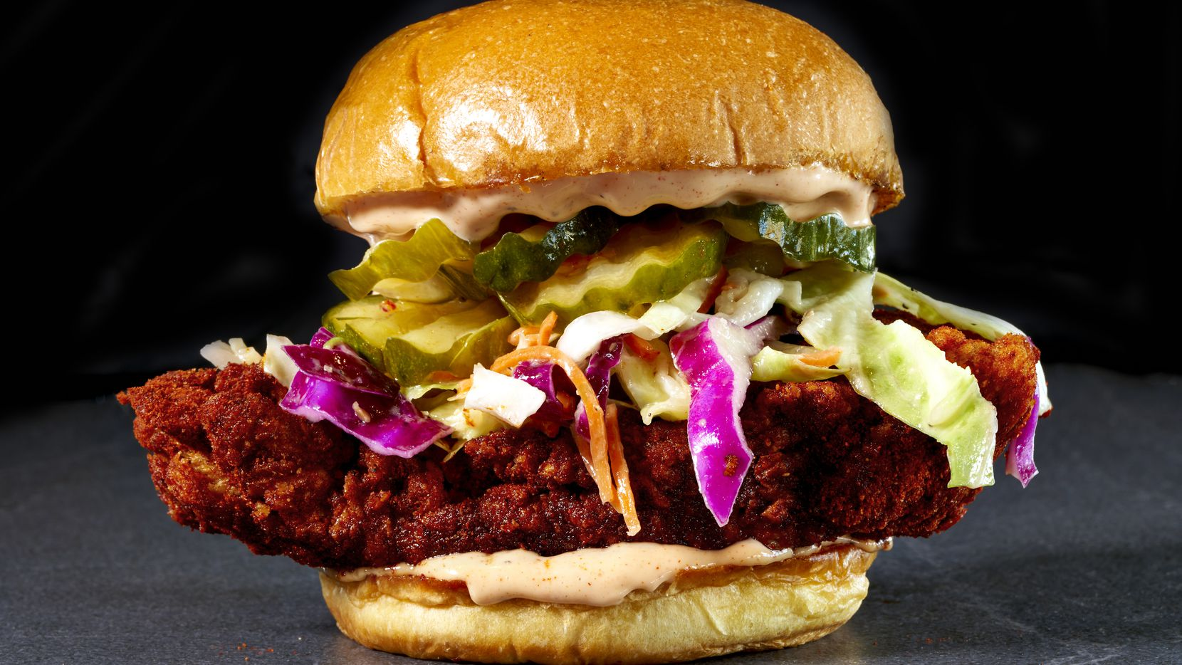 The Sandwich at Hot Chicks comes piled with fried chicken, vinegar slaw, pickles and Hot Chicks sauce. The first Hot Chicks is expected to open in December 2020 in West Plano.