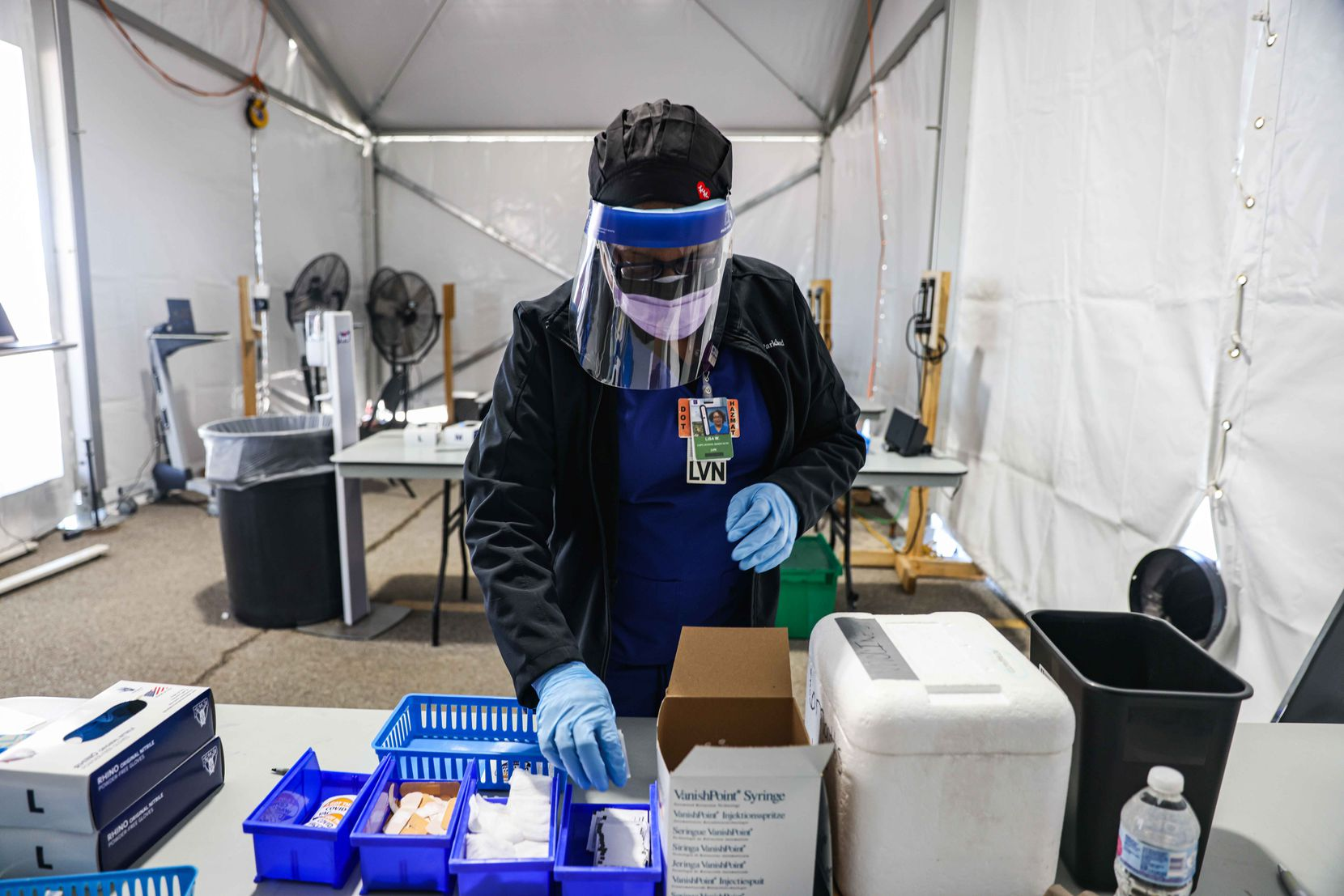 Nurse Lisa Wheeler starts the process to get a dose of the Pfizer-BioNTech COVID-19 vaccine for the next patient at Ellis Davis Fieldhouse, a Parkland Hospital testing and vaccine location, in Dallas on March 3.
