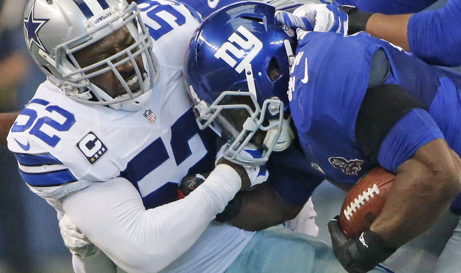 Dallas Cowboys outside linebacker Justin Durant (52) tackles New York Giants running back Andre Williams (44) during the New York Giants vs. the Dallas Cowboys NFL football game at AT&T Stadium in Arlington on Sunday, October 19, 2014.  (Louis DeLuca/The Dallas Morning News)