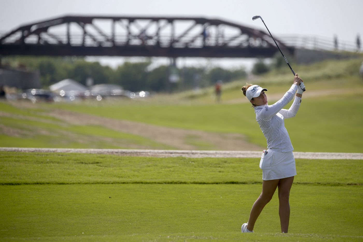Professional golfer Gaby Lopez hits a shot on the No. 2 fairway during the third round of the LPGA VOA Classic on Saturday, July 3, 2021, in The Colony, Texas. (Elias Valverde II/The Dallas Morning News)