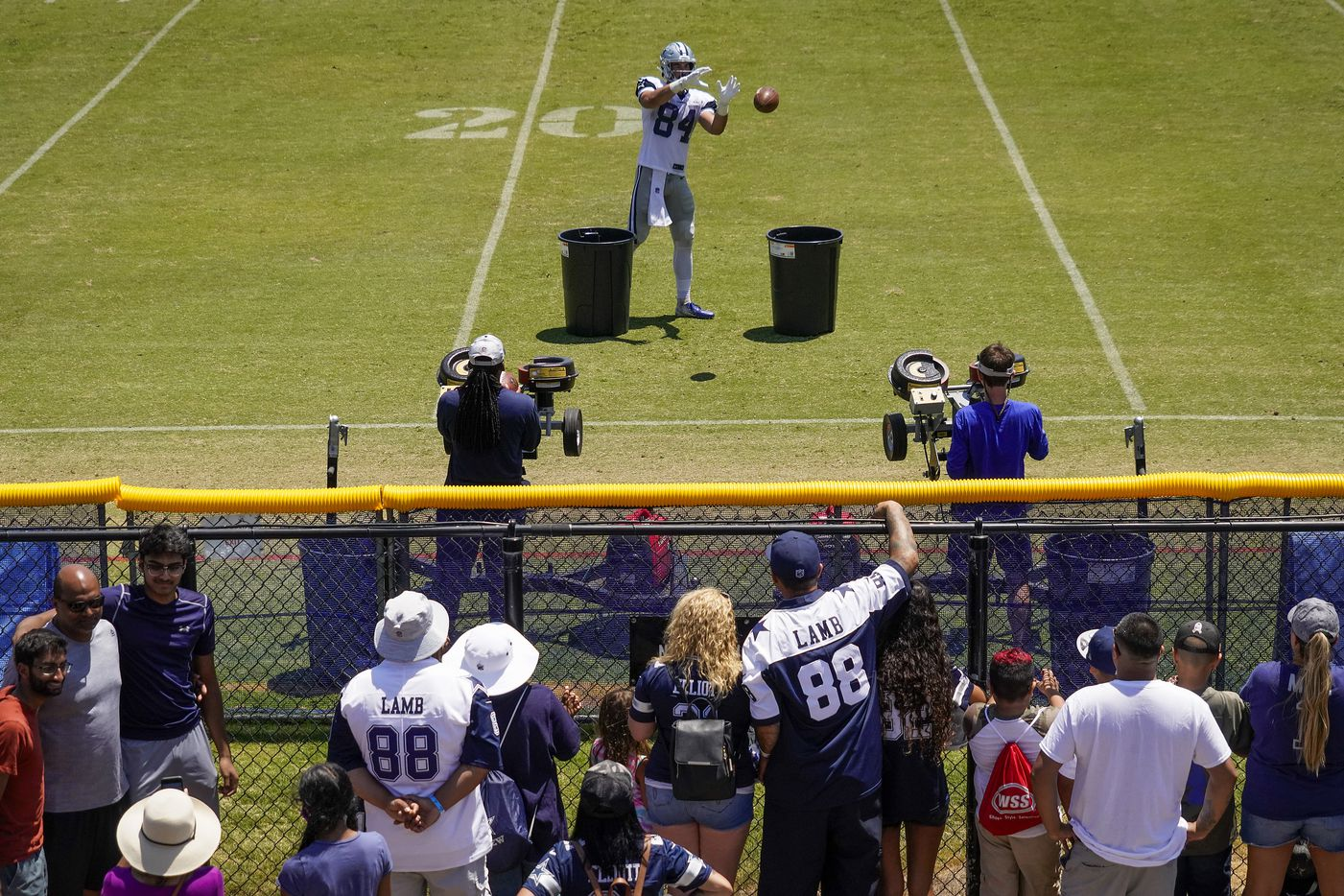 Dallas Cowboys fans press against a fence to get watch tight end Sean McKeon (84) participate in a drill during a practice at training camp on Wednesday, July 28, 2021, in Oxnard, Calif.
