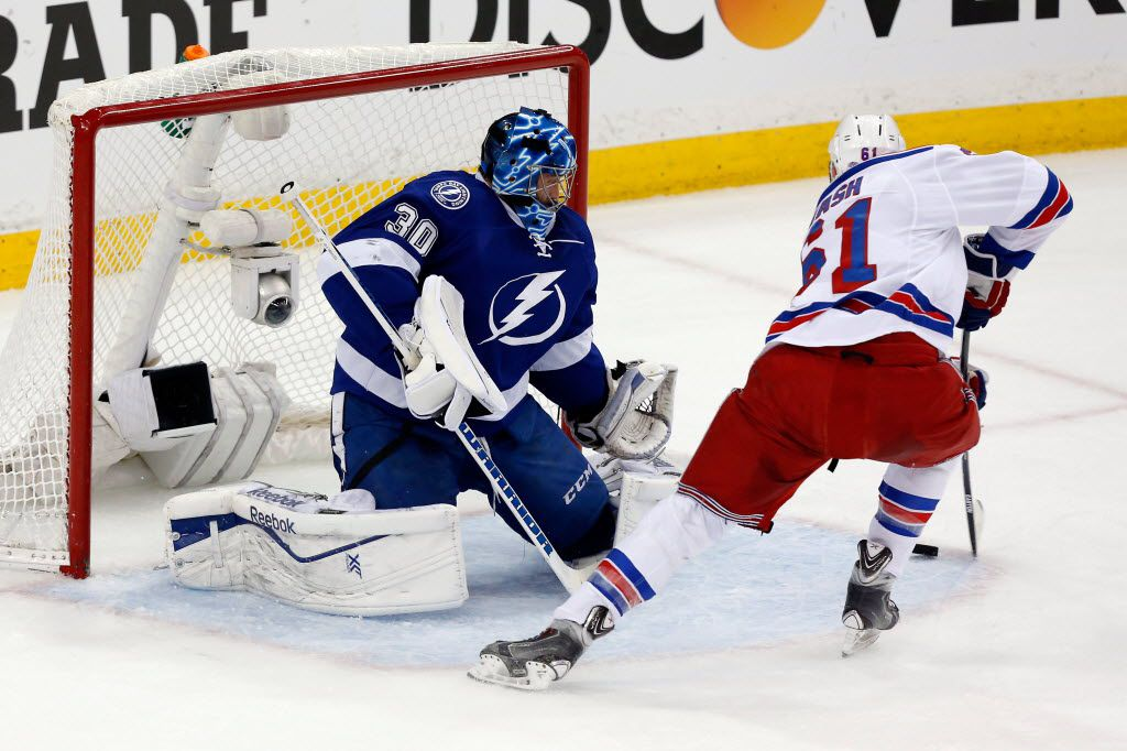 TAMPA, FL - MAY 22:  Rick Nash #61 of the New York Rangers scores a goal during the first period against Ben Bishop #30 of the Tampa Bay Lightning in Game Four of the Eastern Conference Finals during the 2015 NHL Stanley Cup Playoffs at Amalie Arena on May 22, 2015 in Tampa, Florida.  (Photo by Mike Carlson/Getty Images)