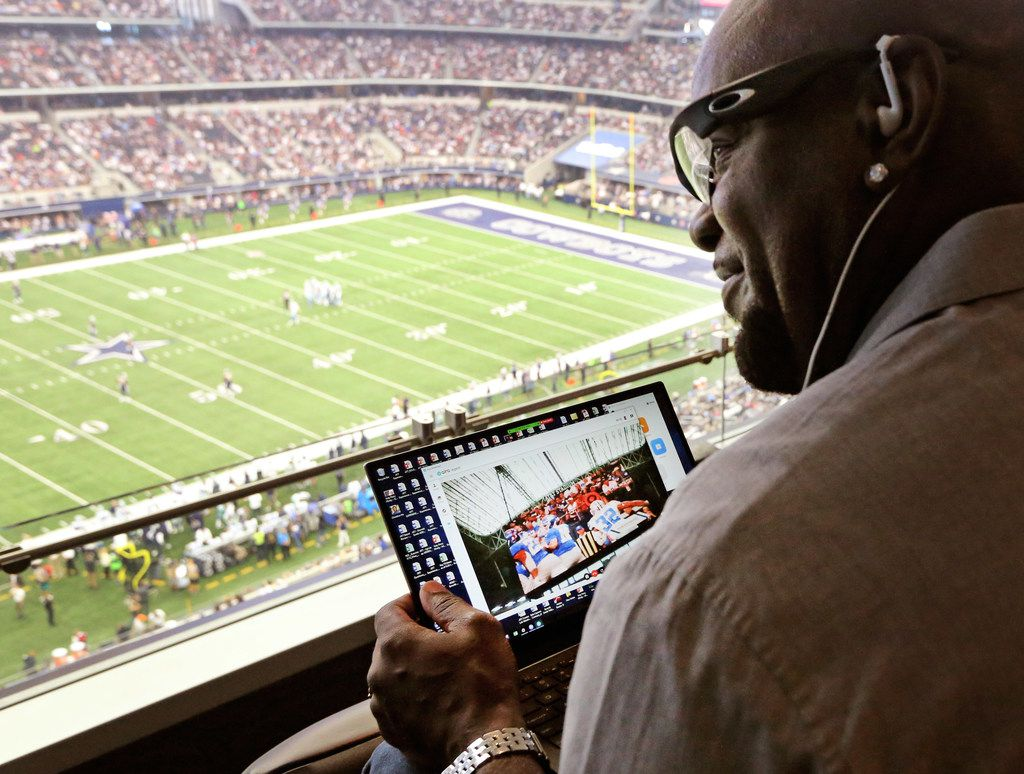 Cowboys Hall of Famer Emmitt Smith uses Aira technology for the blind and visually impaired to provide play-by-play announcing from the suite level for Pete Lane, who is visually impaired and seated in the stands below during the Los Angeles Rams vs. the Dallas Cowboys game at AT&T Stadium on Oct. 1.