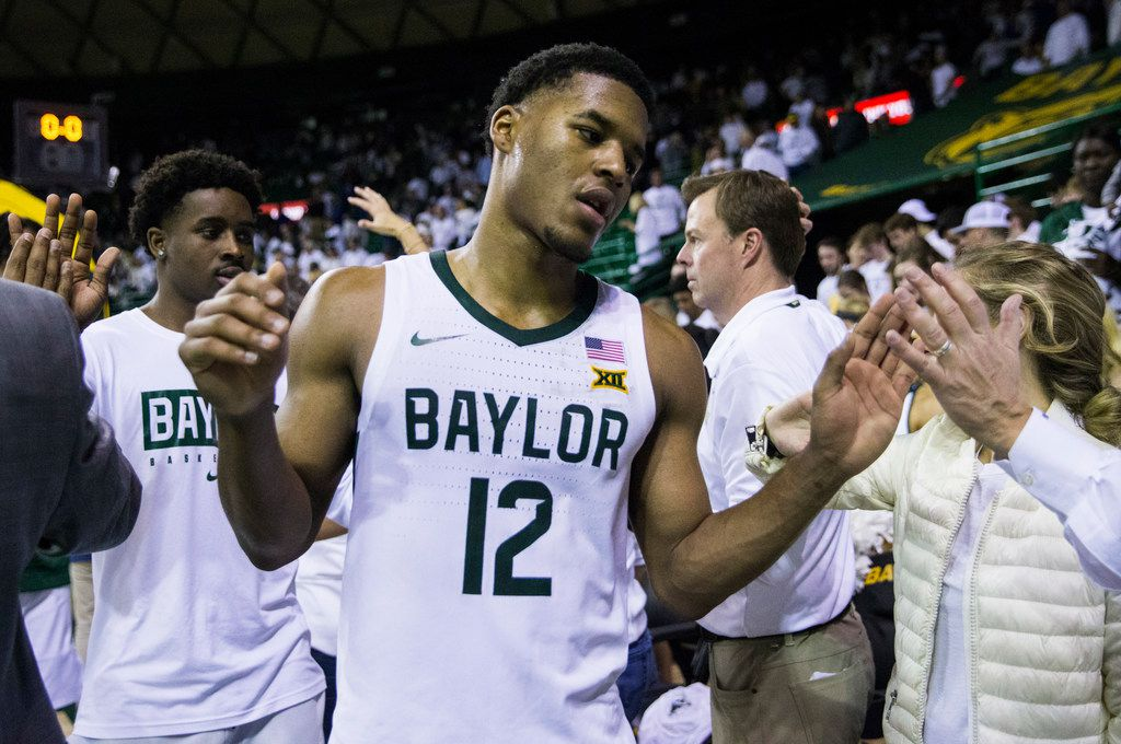 Baylor Bears guard Jared Butler (12) reacts to a 64-61 loss to Kansas Jayhawks after an NCAA men's basketball game between Baylor University and Kansas University on Saturday, February 22, 2020 at Ferrell Center on the Baylor University Campus in Waco.
