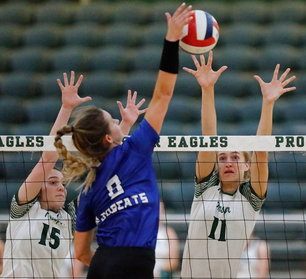 Byron Nelson outside hitter Paige Flickinger (8) attempts to hit past Prosper's Nikki Steinheiser (15) and Shaylee Shore (11) during Byron Nelson's four-set win Tuesday. (Stewart F. House/Special Contributor)