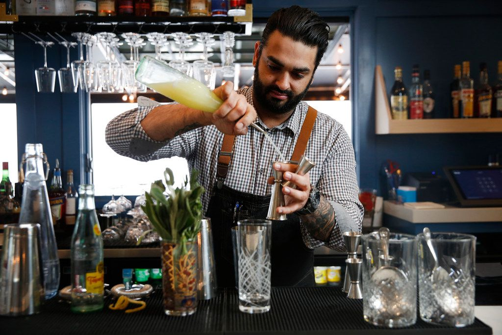 Former RM 12:20 bartender Ravinder Singh mixes a sparkling rosemary and sage mocktail. Mocktails are all the rage in Dallas-Fort Worth right now.