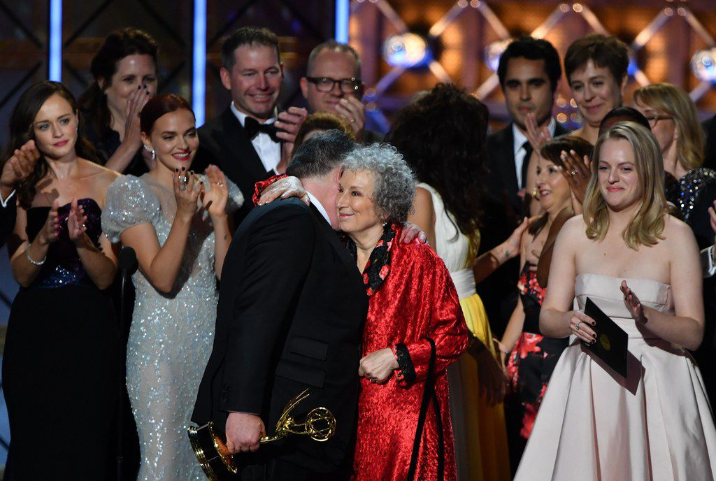 The cast and crew of The Handmaid's Tale accept the award for Outstanding Drama Series during the 69th Emmy Awards at the Microsoft Theatre on Sept. 17, 2017, in Los Angeles. In red is author Margaret Atwood, whose novel the show is based on.