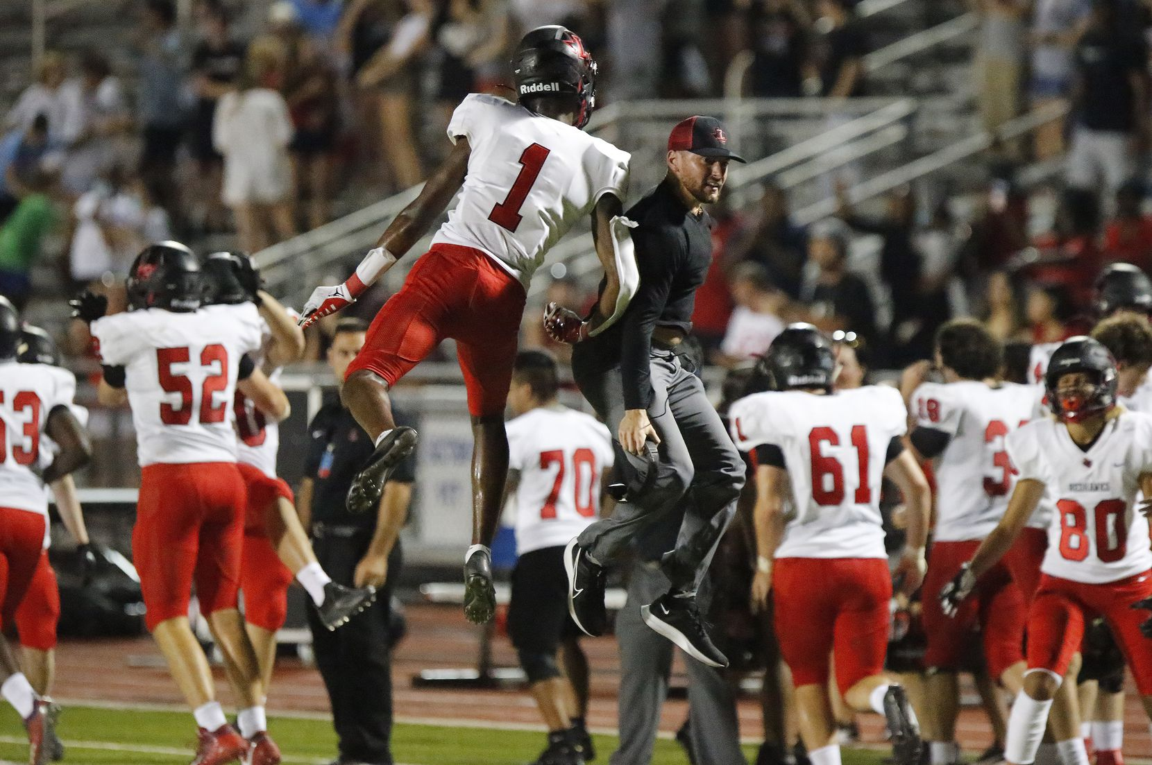 Liberty High School wide receiver Kamryn Smith (1) leaps to congratulate a coach after Liberty made a two point conversion to take a 50-49 lead with 8 seconds left during the second half as Reedy High School hosted Frisco Liberty High School at David Kuykendall Stadium in Frisco on Wednesday night, August 26, 2021. (Stewart F. House/Special Contributor)