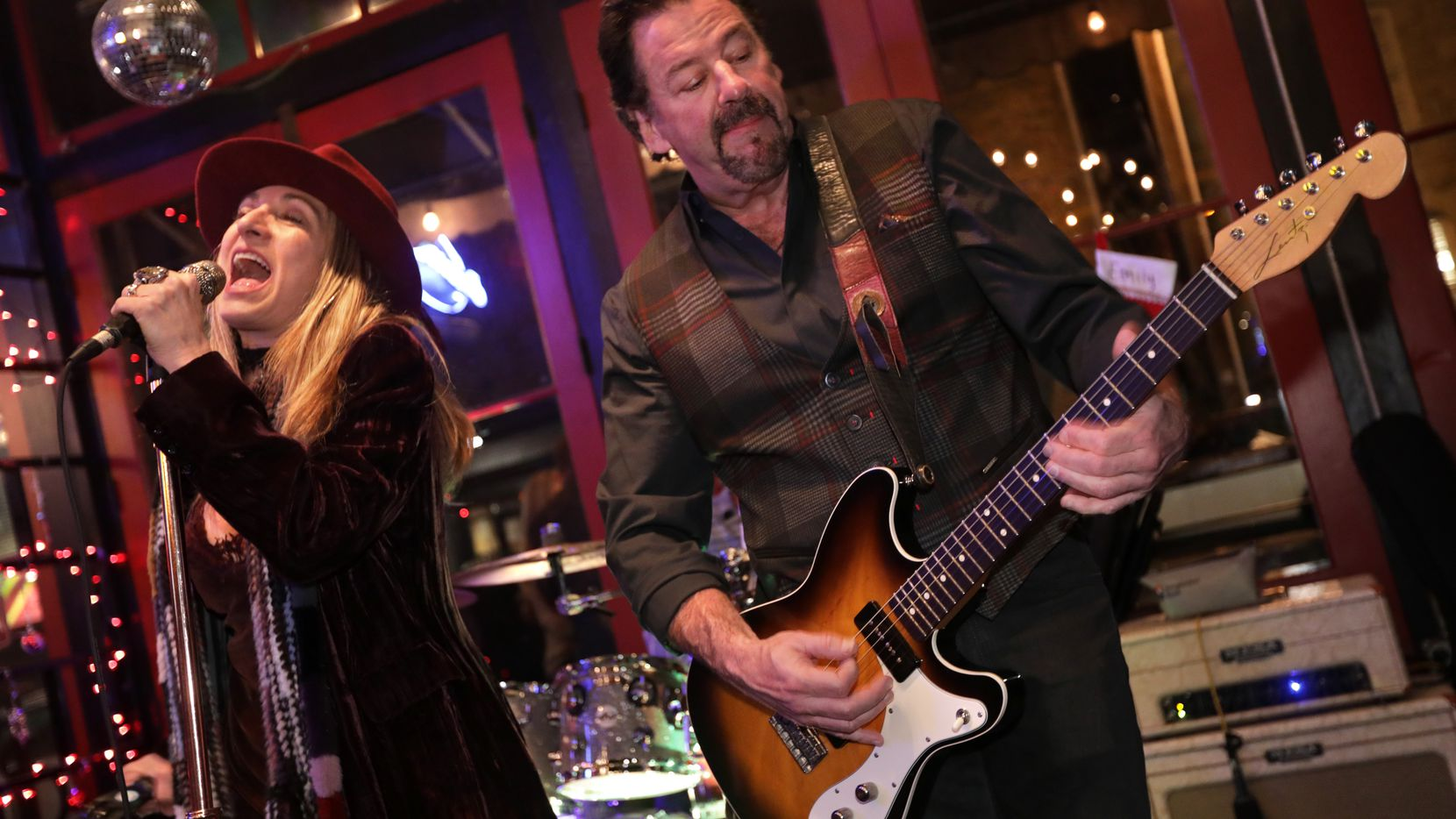 Maylee Thomas, left, and McKinney mayor George Fuller perform with The Maylee Thomas Band performs at Cadillac Pizza Pub in McKinney, TX, on Dec. 21, 2019. (Jason Janik/Special Contributor)