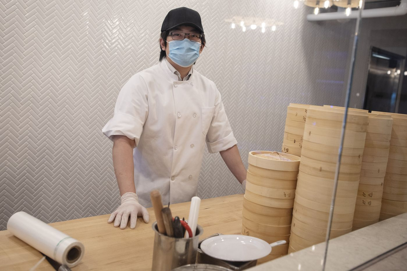 Ian Peng, 22, owner of Kitchen Master, behind the dumpling window inside his restaurant in Frisco, Sunday, May 31, 2020.
