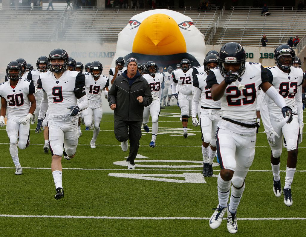 Allen head coach Terry Gambill leads his Eagles players from the team inflatable just prior to the opening kickoff against Waco Midway. The two teams played their Class 6A Division l Region ll final football playoff game at Baylor's McLane Stadium in Waco on December 8, 2018.  (Steve Hamm/ Special Contributor) (NOTE: SPORTS requested that this image be placed into the system for consideration to accompany a future feature on Allen Football).