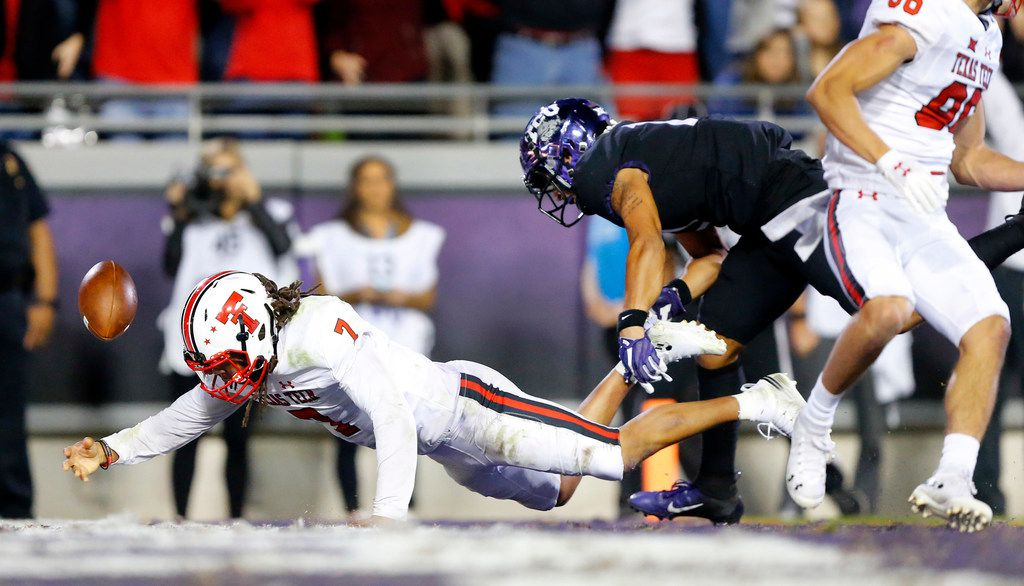 Texas Tech Red Raiders quarterback Jett Duffey (7) falls into the end zone, scoring a long go-ahead touchdown against the TCU Horned Frogs in the fourth quarter at Amon G. Carter Stadium in Fort Worth, Thursday, October 11, 2018. (Tom Fox/The Dallas Morning News)