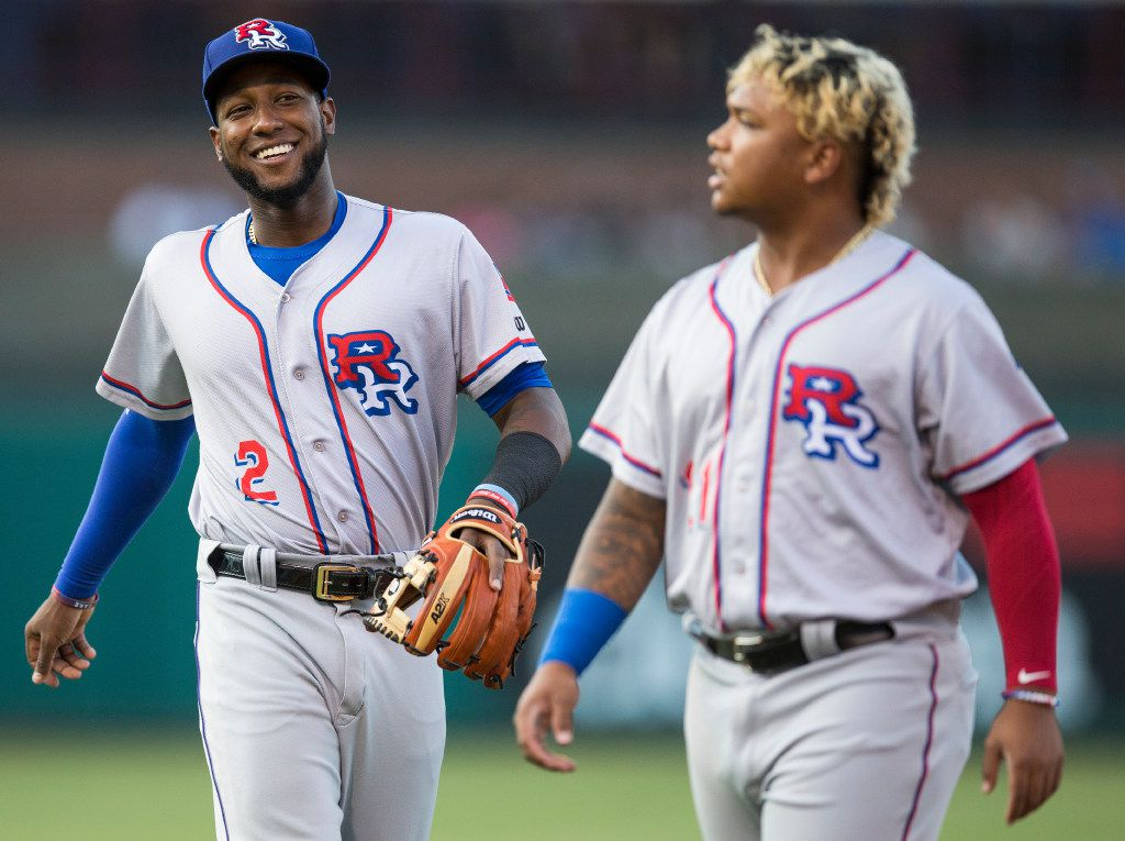 FILE - Jurickson Profar (left) and Willie Calhoun make their way in after the second inning of a matchup between the Round Rock Express and Oklahoma City Dodgers at Chickasaw Bricktown Ballpark on Monday, August 14, 2017 in Oklahoma City. (Ryan Michalesko/The Dallas Morning News)