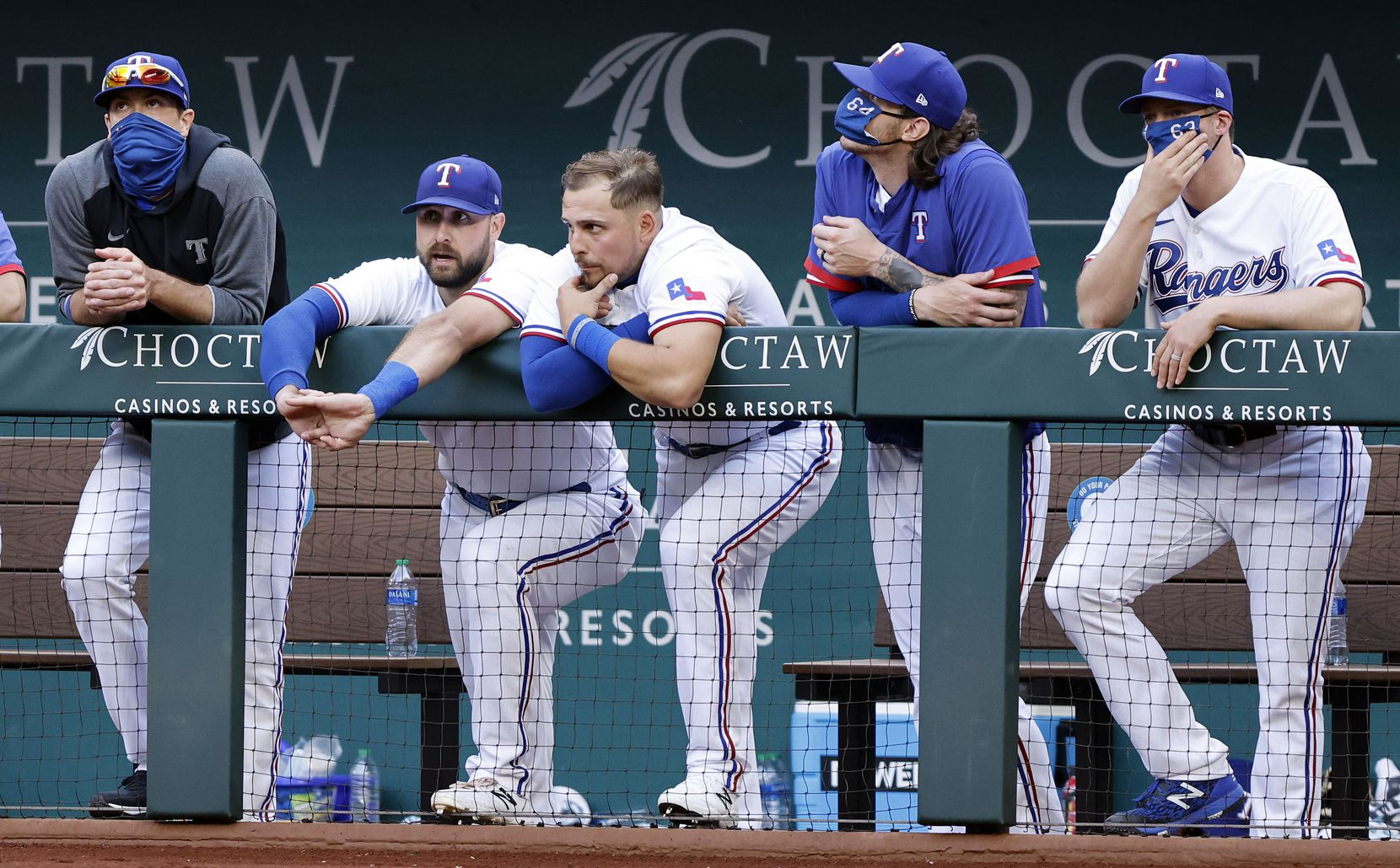 Texas Rangers players hang on the dugout rail late in the ninth inning against the Toronto Blue Jays at Globe Life Field in Arlington, Monday, April 5, 2021. The Texas Rangers were facing the Toronto Blue Jays in their home opener. The Rangers lost, 6-4. (Tom Fox/The Dallas Morning News)